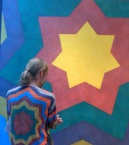 "Me, wearing a Sol LeWitt tee shirt made for the Sao Paolo Biennial of 1996, standing in front of one of LeWitt's ""Stars"" wall drawings at the old Whitney museum."